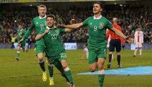 Republic of Ireland striker Shane Long celebrates scoring the equaliser with Wes Hoolahan and James McClean during the Euro 2016 Group D qualifying game  at the Aviva Stadium. Photograph: Niall Carson/PA