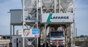 Holcim  and Lafarge  agreed a merger to create the world's biggest cement maker with more than $40 billion in sales and cut overcapacities and energy expenses. However, merger talks appear to be stalling. (Photograph: Balint Porneczi/Bloomberg)
