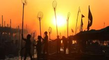 Indian fishermen silhuetted by the rising sun as they prepare for an early morning catch at the banks of Narmada river in Nemawar district Dewas, 200km from Bhopal, Madhya Pradesh, India. Photograph: EPA/SAJNEEV GUPTA