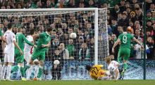 Republic of Ireland striker Shane Long scores their late equaliser against Poland. Photograph: Getty Images