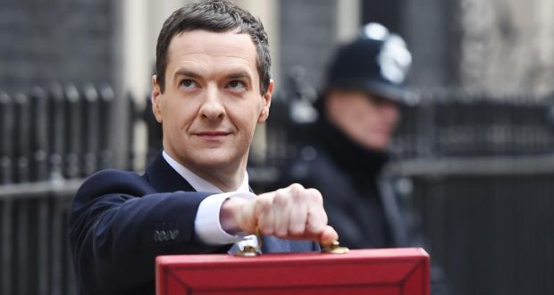 British chancellor of the exchequer George Osborne holds up the red despatch box containing his pre-election budgetas he departs number 11 Downing Street, Westminster. Photograph: Andy Rain/EPA