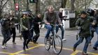 Jeremy Clarkson  surrounded by media personnel as he leaves his home on a bicycle in London on March 26th. The BBC announced Wednesday that it was dropping. Photograph: Justin Tallis/AFP