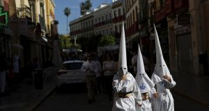 Penitents of La Candelaria brotherhood walk to their church to take part in a Holy Week procession in the Andalusian capital of Seville, southern Spain, March 31, 2015. Holy Week is celebrated in many Christian traditions during the week before Easter. Photograph: Marcelo del Pozo/Reuters