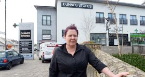 Muireann Dalton stands outside the Dunnes Stores outlet where she works in Newtownmountkennedy in Co Wicklow. Photograph: Eric Luke/The Irish Times