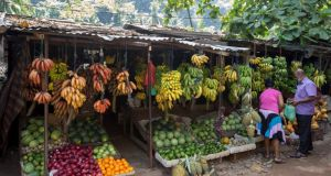 Customers buy fruit at a roadside stall outside Kandy.