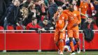 "Wesley Sneijder does a ""baby celebration"" with Jetro Willems after Klaas-Jan Huntelaar's late equaliser for the Netherlands against Turkey in the Euro 2016 qualifier in Amsterdam last week. Photograph: Epa."