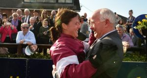 Katie Walsh celebrates with her father Ted after winning the Irish Grand National on Thunder and Roses at Fairyhouse. Photograph Cyril Byrne The Irish Times