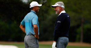 Tiger Woods   and Darren Clarke are all smiles during as they talk  on the practice range  at Augusta National Golf Club ahead of the Masters. Photograph:  Ezra Shaw/Getty Images