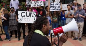 Muhiydin Moye D'Baha addresses the demonstrators at a rally to protest the death of Walter Scott, who was killed by police in a shooting  in North Charleston, South Carolina. It is one of several high profile killings of African Americans by white police officers in the US to have rocked the country in recent months.  Photograph: Richard Ellis/Getty Images