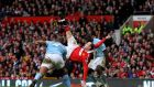 Wayne Rooney scores a memorable goal from an overhead kick during the Manchester derby at Old Trafford in February, 2011. Photograph: Alex Livesey/Getty Images