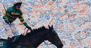 Messages written on a picture of Tony McCoy on a wall at Aintree.