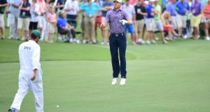 Jordan Spieth jumps to watch his ball during the second round at Augusta National. Photograph: Jim Watson