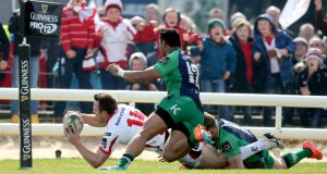 Tommy Bowe goes over for his first of two scores during Ulster's 27-20 win over Connacht at the Sportsground. Photograph: Inpho