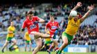 Michael Murphy tries to block down Mark Collins during Cork's victory over Donegal in the national league semi-final in Croke Park. Photograph: Cathal Noonan/Inpho