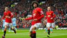 Used the right way: Marouane Fellaini celebrates scoring on Sunday. Photograph:  Darren Staples/Reuters