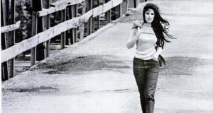 In this photograph from the November 10th, 1967 issue of Life magazine, Bobbie Gentry strolls across the Tallahatchie Bridge in Money, Mississippi. The bridge collapsed in June 1972