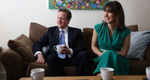 British prime minister and Conservative Party leader David Cameron and his wife Samantha have a cup of tea with a young couple in their home in Swindon. Cameron yesterday outlined his party's manifesto in advance of the general election on May 7th