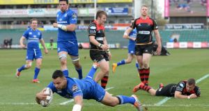 Ben Te'o scores one of his two tries against the Dragons. The New Zealand-born centre's should be key part of a stronger Leinster outfit next season. Photograph: Ian Cooks/Inpho