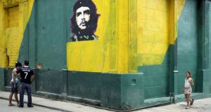 An image of revolutionary hero Ernesto Ché Guevara is seen on a street in Havana. US president Barack Obama met Cuban president Raul Castro on Saturday in the highest-level talks between the two countries in nearly 60 years. Photograph: Enrique de la Osa/Reuters
