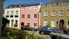Neighbours are not very happy with the red and white striped paint job on a house in South End, Kensington, London. Residents in the quiet cul-de-sac in Kensington, one of London's richest neighbourhoods, said they are being driven 'mad' by the colourful redesign. Photograph: John Stillwell/PA Wire