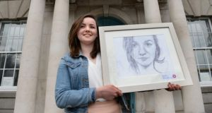 Frances Treanor (18), from Tydavnet, Co Monaghan, with her painting Self Portrait, which was  winner in Category A at the 61st Texaco Children's Art Competition. Photograph: Dara Mac Dónaill/The Irish Times
