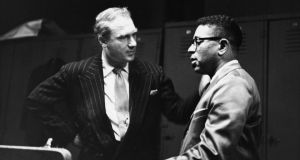 Jazz promoter Norman Granz and Legendary jazz trumpeter Dizzy Gillespie backstage at a Jazz at the Philharmonic concert, 1955. Photgraph: Metronome/Getty Images