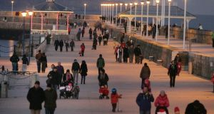Winter walkers on the East Pier in Dun Laoghaire, last evening. Photograph: Cyril Byrne