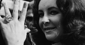 Elizabeth Taylor shows off the rock given to her by Richard Burton. Photograph: Express Newspapers/Hulton Archive/Getty