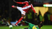 Albert Adomah of Middlesbrough is tackled by Norwich City's Alex Tettey during the English  Championship match at Carrow Road on Friday night. Photograph: Getty.