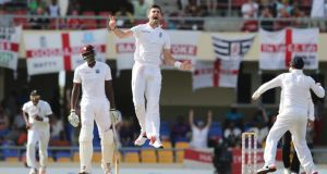 England's James Anderson celebrates taking the wicket of West Indies' Denesh Ramdin in the First Test  in Antigua to break the record for the most Test wickets as an England player previously held by Ian Botham. Photograph: Jason O'Brien/Action Images via Reuters