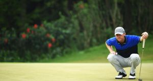 Michael Hoey lines up a putt  of Northern Ireland in action during the third round of the Shenzhen International. Photo: Stuart Franklin/Getty Images