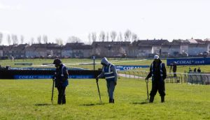Ground staff prepare the course before the 2015 Coral Scottish Grand National Festival at Ayr Racecourse. Photograph: Jeff Holmes/PA