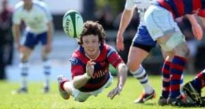 Clontarf's Sam Cronin gets his pass away at Temple Hill. Photo: Ryan Byrne/Inpho