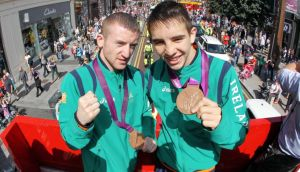 Paddy Barnes and Michael Conlan show off their bronze medals from the London 2012 Games at a homecoming event in Belfast. Photo:  Kelvin Boyes/Inpho/Presseye