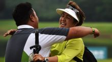Kiradech Aphibarnrat of Thailand celebrates winning with his mother after a play-off against Li Hao-tong of China in  the Shenzhen International at Genzon Golf Club. Photo: Stuart Franklin/Getty Images