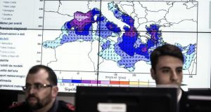 Staff  in the operations room of the Italian Coast Guard in Rome during the co-ordination of relief efforts after a ship carrying hundreds of migrants capsizes off Libyan coast occurred in the Strait of Sicily.  Photograph: Angelo Carconi/EPA