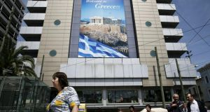 Billboard in central Athens: Greece aims for a deal with creditors, but will not back down on red-line issues. photograph: reuters/alkis konstantinidis Photograph: Reuters/Alkis Konstantinidis