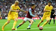 Aston Villa's Jack Grealish looks to evade Liverpool's Martin Skrtel and Emre Can during an impressive display in the FA Cup sem-final. Photograph: Mike Hewitt/Getty Images