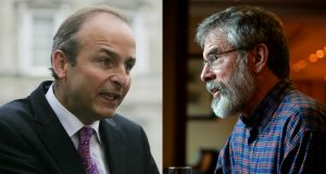 Fianna Fáil party leader Micheál Martin Sinn Féin president Gerry Adams have clashed over legacy issues facing their parties.