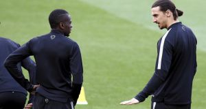 Paris Saint-Germain's Blaise Matuidi  and  Zlatan Ibrahimovic talk before a training session at  the Nou Camp  ahead of Tuesday's Champions League quarter-final second leg against Barcelona. Photo: Gustau Nacarino/Reuters