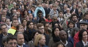 Hundreds of people participate in a silent  ceremony in Vienna, Austria, on Monday to pay their respects to   migrants who died when their vessel capsized in the Mediterranean at the weekend. Photograph: Joe Klamar/AFP/Getty Images