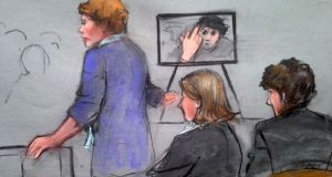 A sketch of assistant US attorney Nadine Pellegrini speaking during the sentencing of Dzhokhar Tsarnaev, who isseen gesturing in a photograph. Photograph: Jane Collins/Reuters
