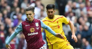 Liverpool's Emre Can  chases Aston Villa  midfielder Jack Grealish during the FA Cup semi-final between Aston Villa and Liverpool at Wembley stadium in London on Sunday. Photograph: Ben Stansall/Getty Images
