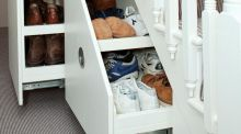 The area under the stairs can often be used as extra storage space