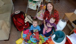 Emma Howlin with son, Ed, and baby daughter, Sadie, with some of their baby stuff at  home in Ashtown, Dublin. Photograph: Dara Mac Dónaill