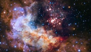 An image showing a region of rapid star formation called Westerlund 2 captured by the Hubble space telescope. This tapestry of your stars resembles a glittering fireworks display and is released to mark 25 years since the launch of Hubble into orbit. Credit: NASA and ESA