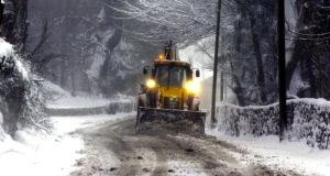 A bulldozer clears a route through the snow for motorists in the Dublin mountains near the Hell Fire Club towards the Sally Gap. File image: Bryan O'Brien/The Irish Times