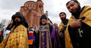 Armenian clergy walk as they attend a commemoration ceremony for Armenians who lost their lives during mass killings under the Ottoman Empire, at the Temple complex of the Armenian Apostolic Church in Moscow. Photograph: Yuri Kotchekov/EPA