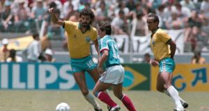 Brazil legend Sócrates confronts Alain Giresse in the quarter-final of the 1986 World Cup in Guadalaraja, Mexico, which France won in a penalty shoutout. Photograph: AFP/Getty
