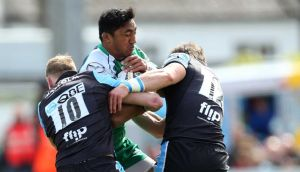 Connacht centre Bundee Aki is tackled by Glasgow's  Finn Russell and Peter Horne during the Guinness Pro 12 game  at the Sportsground in Galway. Photo:  Ryan Byrne/Inpho